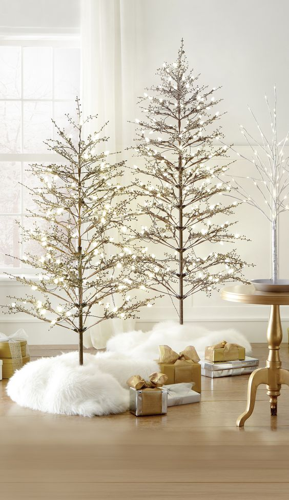 """9317700410 Twig Covered Tree 9293100900 Birch Tree 36"""" 9317600550 Twig Champagne Tree 5451820820 Winterberry  6.5' Tree 5451810820  Winterberry 5' tree 6865700530 Elaina Round Accent Table Shiny Gold"""